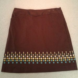 Brown skirt with pockets and polka dots.